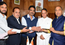IPH MINISTER PRESENTS A CHEQUE OF RS. 5 LAKH TOWARDS CMRF